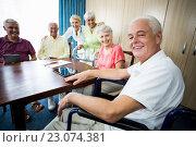 Купить «Seniors with wheelchair and walking aid», фото № 23074381, снято 2 марта 2016 г. (c) Wavebreak Media / Фотобанк Лори