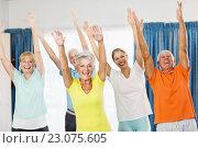 Купить «Instructor doing exercises with seniors», фото № 23075605, снято 2 марта 2016 г. (c) Wavebreak Media / Фотобанк Лори