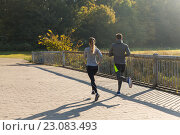 couple running or jogging outdoors. Стоковое фото, фотограф Syda Productions / Фотобанк Лори