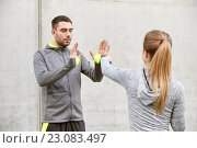 Купить «woman with trainer working out self defense strike», фото № 23083497, снято 17 октября 2015 г. (c) Syda Productions / Фотобанк Лори