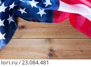 Купить «close up of american flag on wooden boards», фото № 23084481, снято 6 мая 2016 г. (c) Syda Productions / Фотобанк Лори