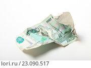 Купить «Мятая купюра 1000 рублей на белом фоне», эксклюзивное фото № 23090517, снято 14 июня 2016 г. (c) Яна Королёва / Фотобанк Лори