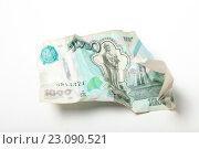 Купить «Скомканная купюра 1000 рублей», эксклюзивное фото № 23090521, снято 14 июня 2016 г. (c) Яна Королёва / Фотобанк Лори
