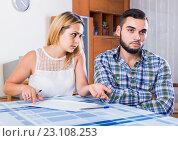 Купить «Financial problems in young family couple», фото № 23108253, снято 12 июля 2020 г. (c) Яков Филимонов / Фотобанк Лори