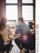 Купить «Graphic designers working at desk in the office», фото № 23122789, снято 10 апреля 2016 г. (c) Wavebreak Media / Фотобанк Лори