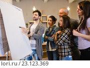 Купить «Team of graphic designer discussing chart on white board», фото № 23123369, снято 10 апреля 2016 г. (c) Wavebreak Media / Фотобанк Лори
