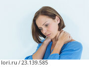 Купить «Woman suffering from neck pain», фото № 23139585, снято 5 апреля 2016 г. (c) Wavebreak Media / Фотобанк Лори