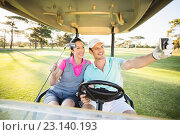 Купить «Smiling golfer couple taking self portrait», фото № 23140193, снято 14 апреля 2016 г. (c) Wavebreak Media / Фотобанк Лори