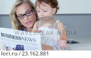 Купить «Blonde mother reading newspaper with her baby at hone», видеоролик № 23162881, снято 10 апреля 2020 г. (c) Wavebreak Media / Фотобанк Лори