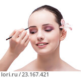 Купить «Beautiful woman during make-up cosmetics session isolated on whi», фото № 23167421, снято 20 июня 2016 г. (c) Elnur / Фотобанк Лори