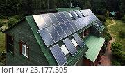 Купить «Деревенский деревянный дом с солнечными панелями», фото № 23177305, снято 22 июня 2016 г. (c) Alexander Tihonovs / Фотобанк Лори