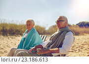 Купить «happy senior couple in chairs on summer beach», фото № 23186613, снято 18 августа 2015 г. (c) Syda Productions / Фотобанк Лори