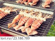 Купить «grilled squids at street market», фото № 23186789, снято 7 февраля 2015 г. (c) Syda Productions / Фотобанк Лори