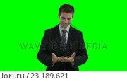 Купить «Businessman showing something with his hands on a virtual touch screen», видеоролик № 23189621, снято 23 ноября 2019 г. (c) Wavebreak Media / Фотобанк Лори