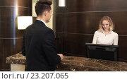 Купить «Young businessmen in a hotel», видеоролик № 23207065, снято 30 июня 2016 г. (c) Raev Denis / Фотобанк Лори