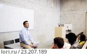 Купить «group of students and teacher in lecture hall», видеоролик № 23207189, снято 23 июня 2016 г. (c) Syda Productions / Фотобанк Лори