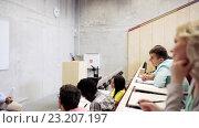 Купить «group of students and teacher in lecture hall», видеоролик № 23207197, снято 23 июня 2016 г. (c) Syda Productions / Фотобанк Лори