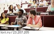 Купить «group of students with notebooks in lecture hall», видеоролик № 23207205, снято 23 июня 2016 г. (c) Syda Productions / Фотобанк Лори