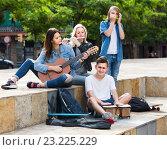 Купить «Portrait of four teenagers playing music together outdoors», фото № 23225229, снято 15 ноября 2018 г. (c) Яков Филимонов / Фотобанк Лори
