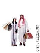Купить «Happy arabic family after shopping isolated on white», фото № 23237981, снято 27 мая 2016 г. (c) Elnur / Фотобанк Лори