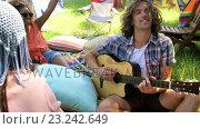 Купить «Hipster man playing guitar», видеоролик № 23242649, снято 17 июля 2019 г. (c) Wavebreak Media / Фотобанк Лори