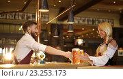 Купить «Bartender and waitress in a pub», видеоролик № 23253173, снято 5 июля 2016 г. (c) Raev Denis / Фотобанк Лори