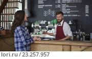Купить «Waiter and customer at a cafe», видеоролик № 23257957, снято 13 июля 2016 г. (c) Raev Denis / Фотобанк Лори