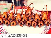Купить «grilled or fried quail on plate at street market», фото № 23258689, снято 7 февраля 2015 г. (c) Syda Productions / Фотобанк Лори