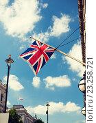 Купить «union jack flag waving on london city street», фото № 23258721, снято 19 июня 2015 г. (c) Syda Productions / Фотобанк Лори