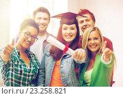 Купить «student girl in graduation cap with diploma», фото № 23258821, снято 16 июня 2013 г. (c) Syda Productions / Фотобанк Лори