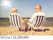 Купить «happy senior couple in chairs on summer beach», фото № 23258889, снято 18 августа 2015 г. (c) Syda Productions / Фотобанк Лори