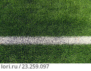 Купить «close up of football field with line and grass», фото № 23259097, снято 14 октября 2015 г. (c) Syda Productions / Фотобанк Лори