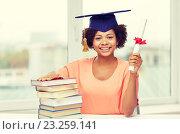Купить «happy african bachelor girl with books and diploma», фото № 23259141, снято 8 июля 2015 г. (c) Syda Productions / Фотобанк Лори