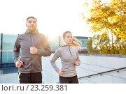 Купить «happy couple running upstairs on city stairs», фото № 23259381, снято 17 октября 2015 г. (c) Syda Productions / Фотобанк Лори