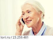 Купить «senior woman with smartphone calling at home», фото № 23259481, снято 10 июля 2015 г. (c) Syda Productions / Фотобанк Лори