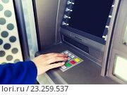 Купить «close up of hand entering pin code at cash machine», фото № 23259537, снято 5 ноября 2015 г. (c) Syda Productions / Фотобанк Лори