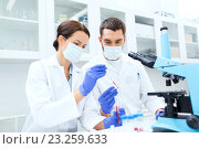 Купить «young scientists making test or research in lab», фото № 23259633, снято 4 декабря 2014 г. (c) Syda Productions / Фотобанк Лори
