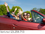 Купить «happy friends driving in cabriolet car at country», фото № 23259713, снято 28 мая 2016 г. (c) Syda Productions / Фотобанк Лори