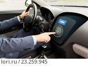 Купить «close up of man in car with starter on computer», фото № 23259945, снято 17 июля 2015 г. (c) Syda Productions / Фотобанк Лори