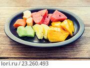 Купить «plate of fresh juicy fruits at asian restaurant», фото № 23260493, снято 14 февраля 2015 г. (c) Syda Productions / Фотобанк Лори