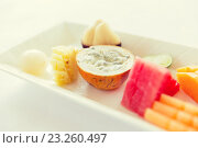Купить «plate of fresh juicy fruit dessert at restaurant», фото № 23260497, снято 21 февраля 2015 г. (c) Syda Productions / Фотобанк Лори