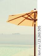 Купить «view from infinity edge pool with parasol to sea», фото № 23260505, снято 14 февраля 2015 г. (c) Syda Productions / Фотобанк Лори