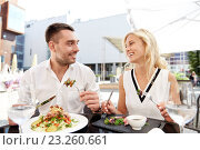 happy couple eating dinner at restaurant terrace. Стоковое фото, фотограф Syda Productions / Фотобанк Лори