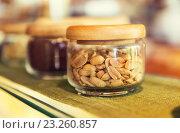 Купить «close up of jars with peanuts at grocery store», фото № 23260857, снято 15 февраля 2015 г. (c) Syda Productions / Фотобанк Лори
