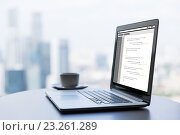 Купить «close up of laptop and coffee cup on office table», фото № 23261289, снято 17 февраля 2015 г. (c) Syda Productions / Фотобанк Лори