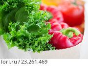 Купить «close up of paper bag with vegetables and greens», фото № 23261469, снято 3 июня 2016 г. (c) Syda Productions / Фотобанк Лори