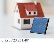 Купить «close up of house model and solar battery or cell», фото № 23261481, снято 3 июня 2016 г. (c) Syda Productions / Фотобанк Лори