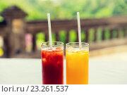 Купить «glasses of fresh fruit juice at restaurant», фото № 23261537, снято 21 февраля 2015 г. (c) Syda Productions / Фотобанк Лори