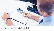 Купить «businessman with notebook and calculator», фото № 23261813, снято 9 июня 2013 г. (c) Syda Productions / Фотобанк Лори