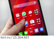 Купить «Экран смартфона с приложением WhatsApp», фото № 23264601, снято 15 июля 2016 г. (c) Victoria Demidova / Фотобанк Лори